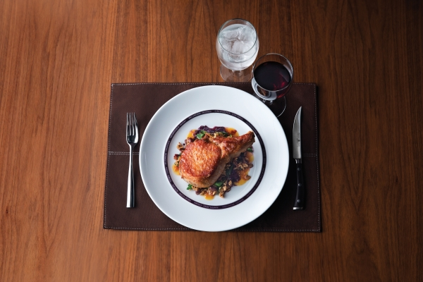 American Icon Grill features comfort-style dishes like Apricot Glazed Pork Chop.