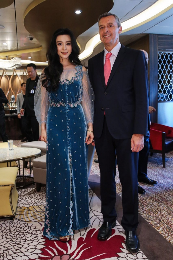 June 24, 2016 - Ovation of the Seas' godmother Fan BingBing and President and CEO of Royal Caribbean International, Michael Bayley, participate in the ship's official naming ceremony.