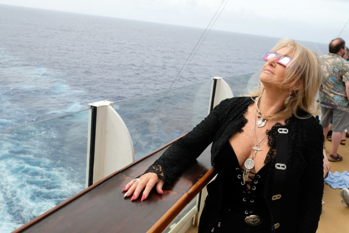 """Total Eclipse of the Heart"" singer Bonnie Tyler glances up at the Great American Eclipse aboard Royal Caribbean's Oasis of the Seas on Mon., Aug. 21. The ship set sail along the path of totality, offering Tyler and fellow passengers an unobstructed view at sea. The ship was the only place on Earth where people could see the legendary songstress sing ""Total Eclipse of the Heart,"" her 1983 megahit, alongside DNCE. They performed during the eclipse, in the ship's signature AquaTheater."