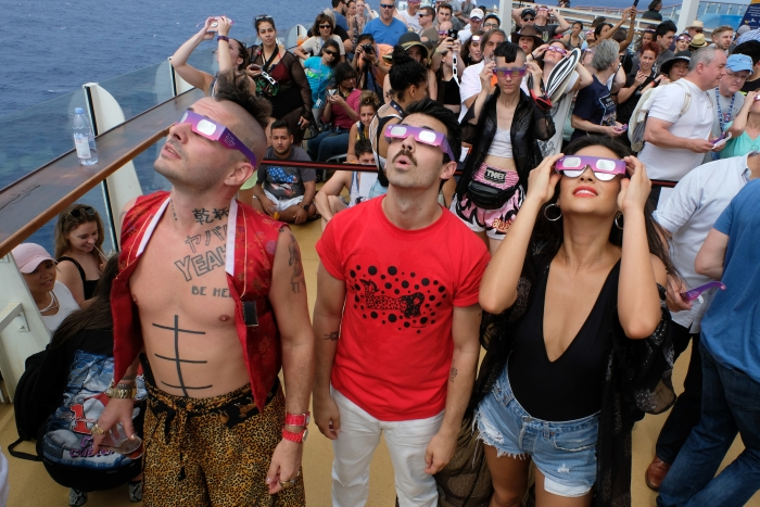 Cole Whittle and Joe Jonas of multi-platinum-selling band DNCE, joined actress Shay Mitchell to celebrate the Great American Eclipse aboard Royal Caribbean's Oasis of the Seas, Mon., Aug. 21. The ship set sail along the path of totality, offering guests a once-in-a-lifetime view of the epic celestial event.