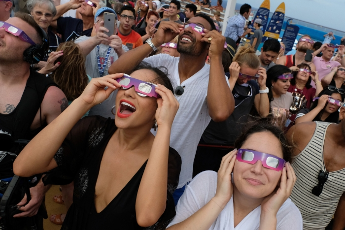 Actress and Royal Caribbean Adventurist, Shay Mitchell bears witness to the Great American Eclipse aboard Royal Caribbean's Oasis of the Seas, on Mon., Aug. 21. The ship set sail along the path of totality, offering Mitchell and fellow passengers an unobstructed view at sea.