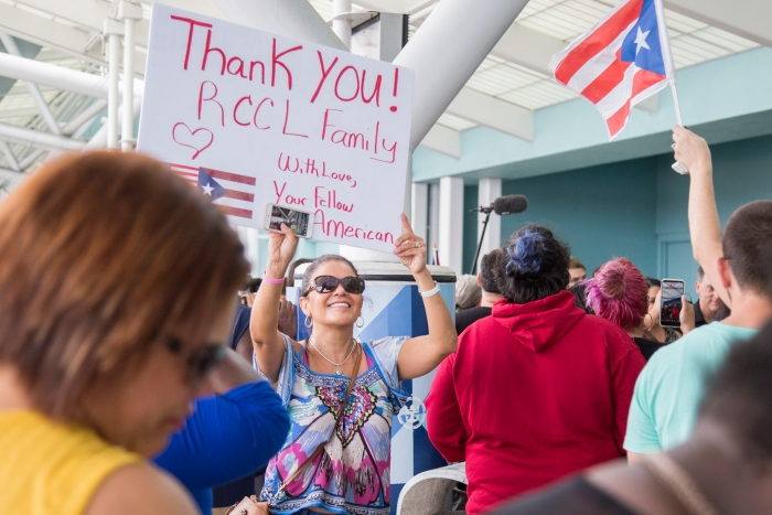 Family and friends welcome evacuees from islands affected by Hurricane Maria on Tuesday, Oct. 3, 2017 in Fort Lauderdale, Fla. They arrived to Port Everglades on board Royal Caribbean International's Adventure of the Seas following a humanitarian relief trip to Puerto Rico, St. Croix and St. Thomas. (Jesus Aranguren/AP Images for Royal Caribbean)