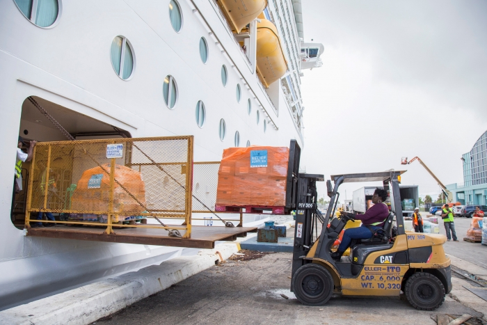 Supplies are loaded onto Royal Caribbean International's Adventure of the Seas ahead of the ship's return to San Juan on Oct. 6, Tuesday, Oct. 3, 2017 in Fort Lauderdale, Fla. The cruise line has delivered nearly one million cases of relief supplies to affected islands in the Caribbean. (Jesus Aranguren/AP Images for Royal Caribbean)
