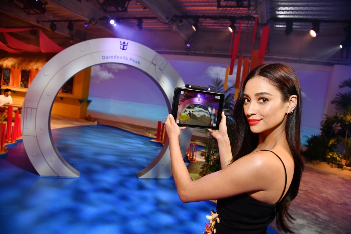 Actress Shay Mitchell takes new augmented reality technology for a test drive, getting a virtual look at Royal Caribbean's new Perfect Day at CocoCay, Bahamas private island destination during an event at Seaport District NYC on Wednesday, March 14, 2018 in New York. (Photo by Charles Sykes/Invision for Royal Caribbean/AP Images)