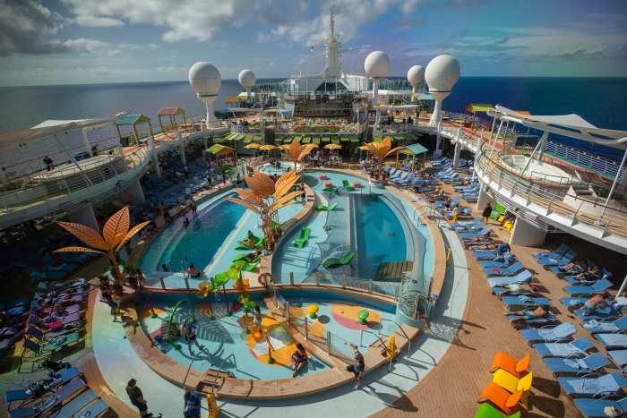 "Navigator of the Seas' Caribbean resort-style deck touts more pool for everyone – even a Splash Pad for tots – and tasty dining options Johnny Rockets Express and Mexican ""street fare"" at El Loco Fresh."