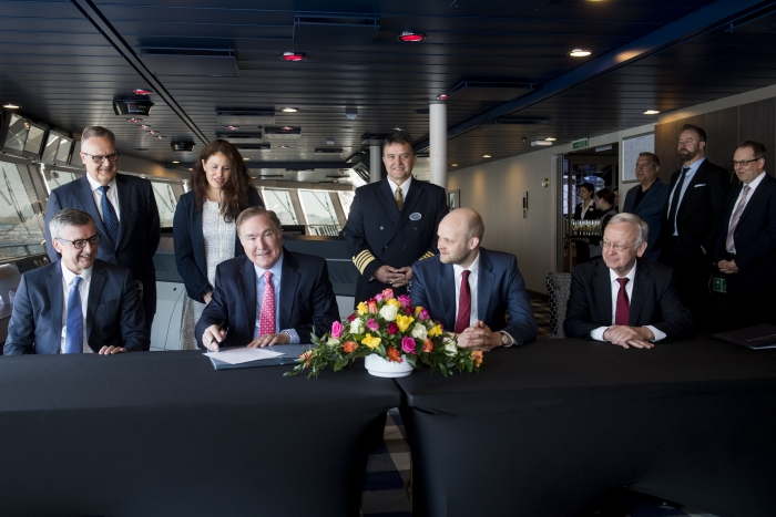 Royal Caribbean International, the world's largest cruise line, officially took delivery of the 26th ship in its fleet, Spectrum of the Seas, in a ceremony held today in Bremerhaven, Germany. Pictured from left to right are: President and CEO of Royal Caribbean International Michael Bayley;  Royal Caribbean Cruises Ltd. Chairman and CEO Richard D. Fain; Meyer Werft Yard's Managing Director Tim Meyer; and Meyer Werft Yard's Managing Partner Bernard Meyer. The first in the Quantum Ultra class of ships, Spectrum will homeport from Shanghai starting June 2019.