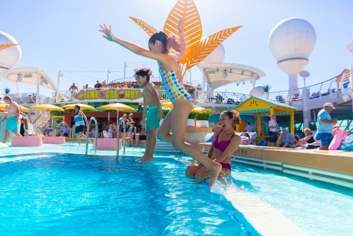 "March 2019 – Navigator of the Seas' Caribbean resort-style poolscape touts more pool for everyone – even a Splash Pad for tots – a new, signature bar, The Lime and Coconut; and tasty dining options Johnny Rockets Express and Mexican ""street fare"" at El Loco Fresh."