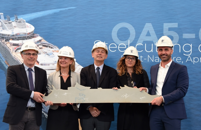The revolutionary Oasis Class will soon have a new sister, as today Royal Caribbean International celebrated the steel cutting of a fifth Oasis Class ship, scheduled to be delivered in 2021. The steel cutting, marking the official start of construction, took place at the Chantiers de l'Atlantique shipyard in Saint-Nazaire, France.Pictured from left to right :Jean-Yves Jaouen, SVP, Operations, Chantiers de l'Atlantique; Florence Mauduit, Oasis Contract Director, Chantiers de l'Atlantique; Laurent Castaing, General Manager, Chantiers de l'Atlantique; Beatrice Siri, Associate Vice-President, Architectural Design and Outfitting, Royal Caribbean; Joseph Pineau, Directo,r Newbuid, Royal CaribbeanPhoto Rights : Bernard Biger/Chantiers de l'Atlantique