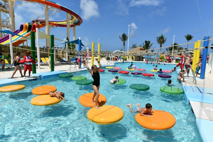 The new Perfect Day at CocoCay touts the Adventure Pool interactive obstacle course that features floating lily pads, a rock wall and two swing ropes for kids of all ages to climb, jump and bounce to their heart's content.