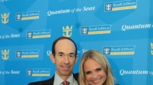 "April 16, 2013 - Royal Caribbean International President and CEO Adam Goldstein and Kristin Chenoweth, godmother of Quantum of the Seas, enjoy a ride on a bumper car following the announcement of Royal Caribbean International's newest ship Quantum of the Seas. Quantum of the Seas will take a dramatic leap forward, introducing more game-changing ""firsts at sea"" such as a skydiving experience, a thrilling adventure that transports guests more than 300 feet in the air on a breathtaking journey; cutting-edge transformative venues including the largest indoor sports and entertainment complex at sea with bumper cars, roller skating and more; and the cruise line's largest and most advanced staterooms ever. (Photo: Tim Aylen)(Photo: Tim Aylen)"