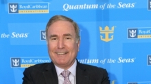 "April 16, 2013 - Royal Caribbean Cruises Ltd. Chairman and CEO Richard Fain enjoys a ride on a bumper car following the announcement of Royal Caribbean International's newest ship Quantum of the Seas. Quantum of the Seas will take a dramatic leap forward, introducing more game-changing ""firsts at sea"" such as a skydiving experience, a thrilling adventure that transports guests more than 300 feet in the air on a breathtaking journey; cutting-edge transformative venues including the largest indoor sports and entertainment complex at sea with bumper cars, roller skating and more; and the cruise line's largest and most advanced staterooms ever. (Photo: Tim Aylen)"