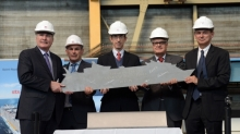 Royal Caribbean International cut the first piece of steel today for its third Oasis-class ship, marking the first construction milestone for a vessel that, at approximately 227,700 GRT, will be the world's largest and most innovative cruise ship. Royal Caribbean Cruises, Ltd.'s Chairman and Chief Executive Officer, Richard D. Fain, Yves Joaven, operations director, STX France, Royal Caribbean International President and CEO, Adam Goldstein, Executive Vice President Newbuild and Fleet Design, Harri Kulovaara and Laurent Castaing, chief executive officer, STX France attended the event at the STX shipyard in Saint-Nazaire, France, where the ship will be built. The cruise line's third Oasis-class ship is expected to be delivered in mid-2016.