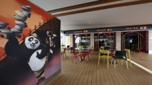 Royal Caribbean International and DreamWorks Animation commemorated the grand opening of the Kung Fu Panda Noodle Shop, a new family style eatery on board <em>Quantum of the Seas</em> and the first-ever DreamWorks Animation Kung Fu Panda themed restaurant on land or at sea.
