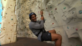 Dhani Jones Climbs Freedom of the Seas Rock Wall