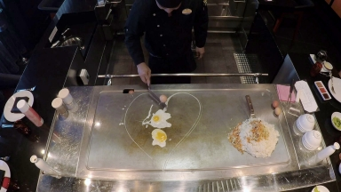 Cooking Up A Storm: Hibachi Chefs Delight Izumi Guests on Royal Caribbean